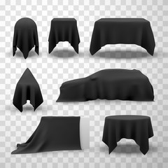 Collection of black satin clothes covering tables