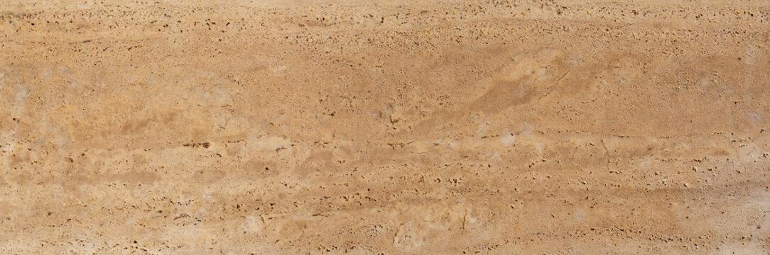 Yellow limestone tiles pool surface closeup texture background.