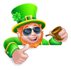 A Leprechaun St Patricks Day cartoon character wearing cool sunglasses. Holding a pipe peeking over a sign and giving a thumbs up