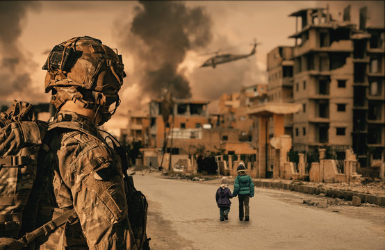 Military soldier looking at kids walking in destroyed city