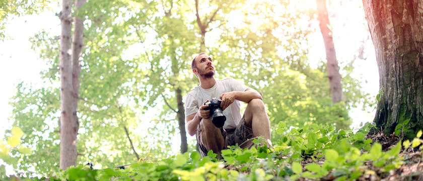 Photographer sitting in nature
