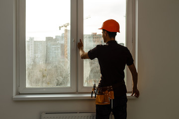 Workman repairing a large picture window