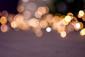 The background is a golden bokeh of the glare of garland lights. Defocus.