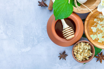 Top view of set for relaxing healing thai spa treatments. Wooden mortar pounder with herbs, honey...