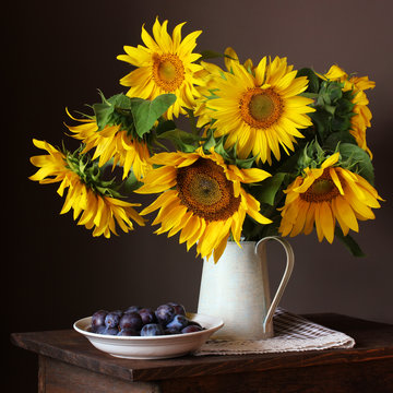sunflowers and plums. bouquet of large yellow sunflowers