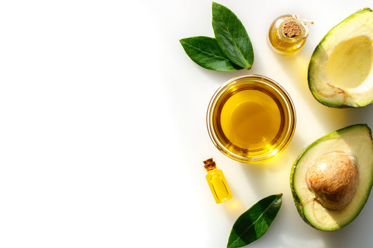 Avocado oil for healthy skin and hair on a white background.
