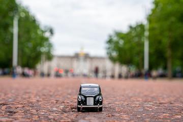 Beautiful London traffic. Traditional black cab driving through Londons most famous landmarks.