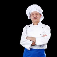 Senior cook professional against black background