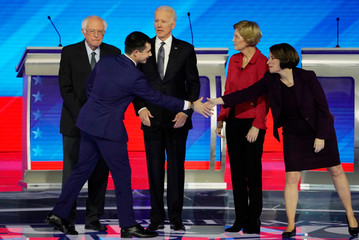 Democratic 2020 U.S. presidential candidates pose together before the start of their debate in Manchester, New Hampshire, U.S.