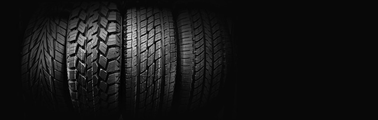 Car tires on black background for copy space
