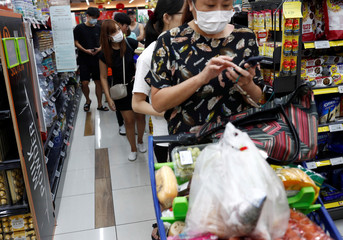 People stock up on food supplies after Singapore raised coronavirus outbreak alert level to orange, at a supermarket in Singapore