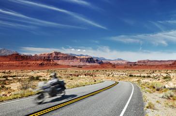 Motorcycle traveler on highway