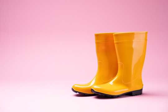 Yellow Rubber Boots On Pink Background