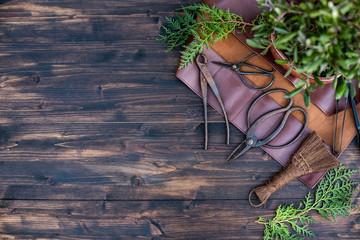 Foto op Plexiglas Bonsai Bonsai tools in leather case on dark wooden background