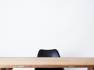 Wood table and modern black chair.