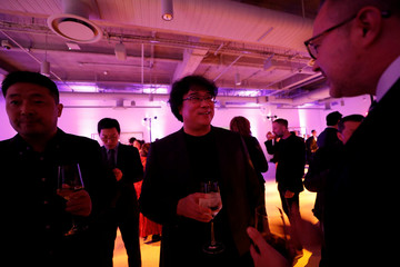 "South Korean director Bong Joon Ho, nominee for ""Parasite,"" attends the Academy's party for the Best International Feature Film nominees at the Academy Museum of Motion Pictures in Los Angeles"