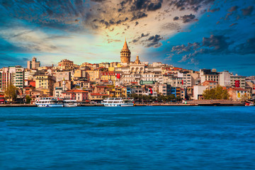 Galata Tower in istanbul City of Turkey. View of the Istanbul City of Turkey with bosphorus, seagulls and boats at bright sky and sunset or night.  Fototapete