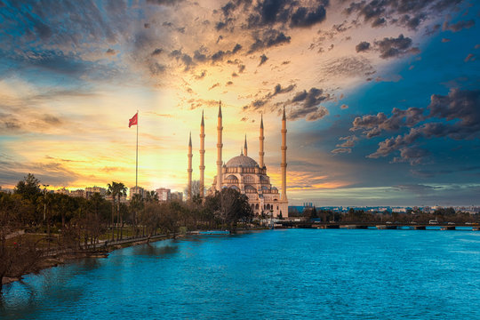 Sabanci Central Mosque, Old Clock Tower and Stone Bridge in Adana, city of Turkey. Adana City with mosque minarets in front of Seyhan river.