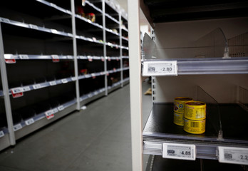 People stock up on food supplies after Singapore raised coronavirus outbreak alert level to orange