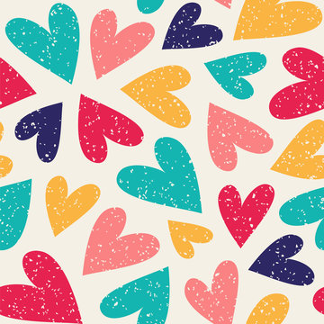 Seamless vector pattern with colorful hearts. Can be used for wallpaper, pattern fills, web page background, fabric, surface textures,  wrapping paper, scrapbook.