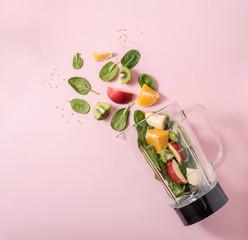 Smoothie ingredients in mixer, smoothie preparation with spinach, apple, orange, kiwi, healthy...