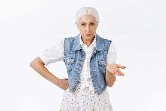 Annoyed serious-looking impatient senior woman cant understand what your deal, raise hand dismay, stare questioned, frustrated and bothered with weird person asking stupid question, white background