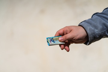 Man hand giving money like a bribe or tips. Holding EURO banknotes on a blurred background, EURO currency