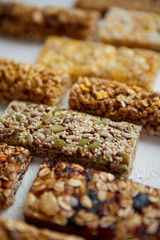 Close up on healthy granola fit bars arragement. Placed on white table