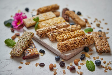 Various kinds of protein granola bars with dry fruits and berries