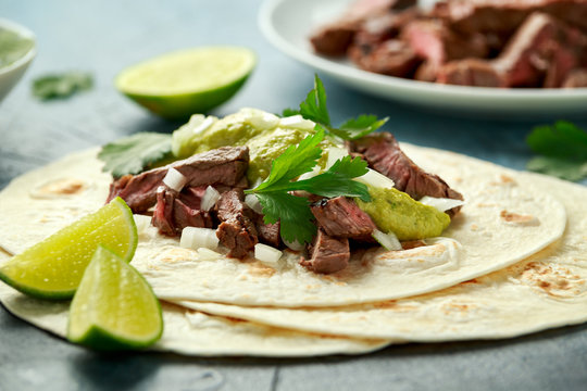 Carne Asada Tacos with grilled steak, green sauce and onion. Mexican food