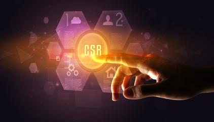 Hand touching CSR inscription, new technology concept