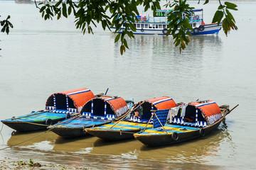 Traditional wooden fishing boats in river Hooghly or Ganga. Kolkata. India