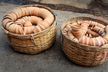 Clay cups in basket on the street. Kolkata. India