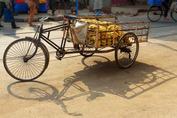 Cargo cycle rickshaw with bananas on the road. Kolkata. India