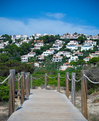 View on the wooden platform and blue sea on Menorca, Balearic Islands, Spain. Beach Son Bou