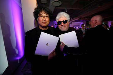 Directors  Ho and Almodovar hold their certificates of nomination at the Academy's party for the Best International Feature Film nominees at the Academy Museum of Motion Pictures in Los Angeles