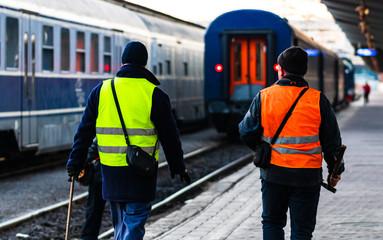 Train crew doing the last checking on the platform at the Bucharest North Railway Station (Gara de Nord Bucuresti) in Bucharest, Romania, 2020