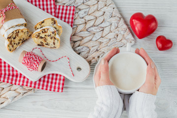 A cup of coffee or cappuccinoand Christmas baking on wooden background