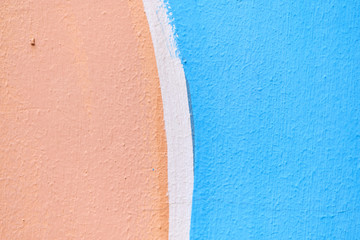 Abstract texture of plaster of blue, beige with a white stripe of color.