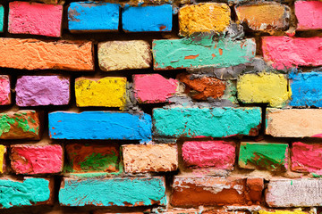 crumbling brick wall in different colors painted.