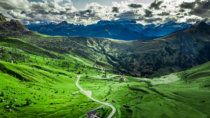 Wall Mural - Winding road in Passo Giau in Dolomites, aerial view, Europe