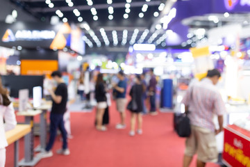 Abstract blur people in exhibition hall event trade show expo background. Business convention show, job fair, or stock market. Organization or company event, commercial trading