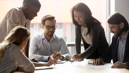 Employees with team leader working on new project at meeting