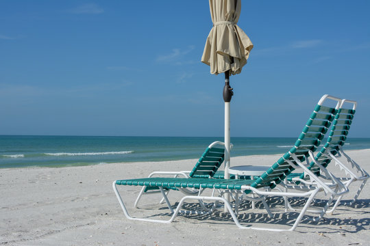 Beach chairs on a white sand beach on Florida's Longboat Key