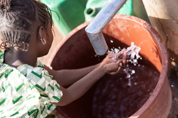Cute African Ethnicity Offspring Transporting nutritious Water for an insufficiency concept