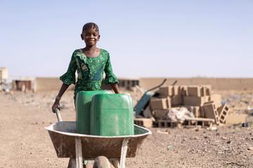 Cute African Girl Carrying Fresh Water in Bamako