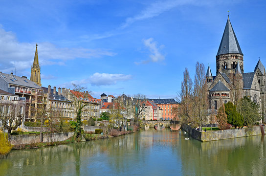 """Temple Neuf meaning in French """"New Temple"""" is a protestant church in Metz, France, It is surrounded by Moselle river."""