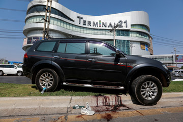 A car that belongs to a victim is seen in front of the Terminal 21 shopping mall following a gun battle involving a Thai soldier on a shooting rampage, in Nakhon Ratchasima