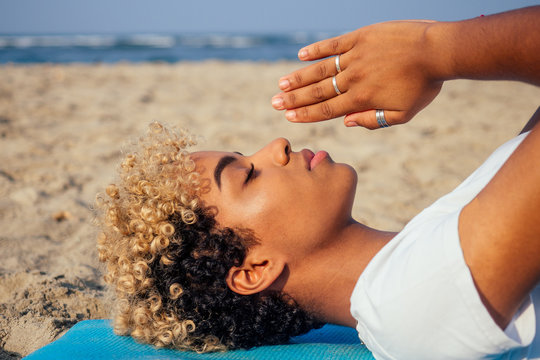 brazilian hispanic woman training yoga on the beach