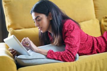 Persian woman at home using digital tablet